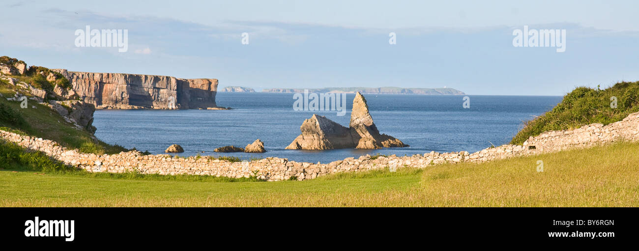 Church Rock, near Broad Haven South, Pembrokeshire. Caldy Island visible in the background. - Stock Image
