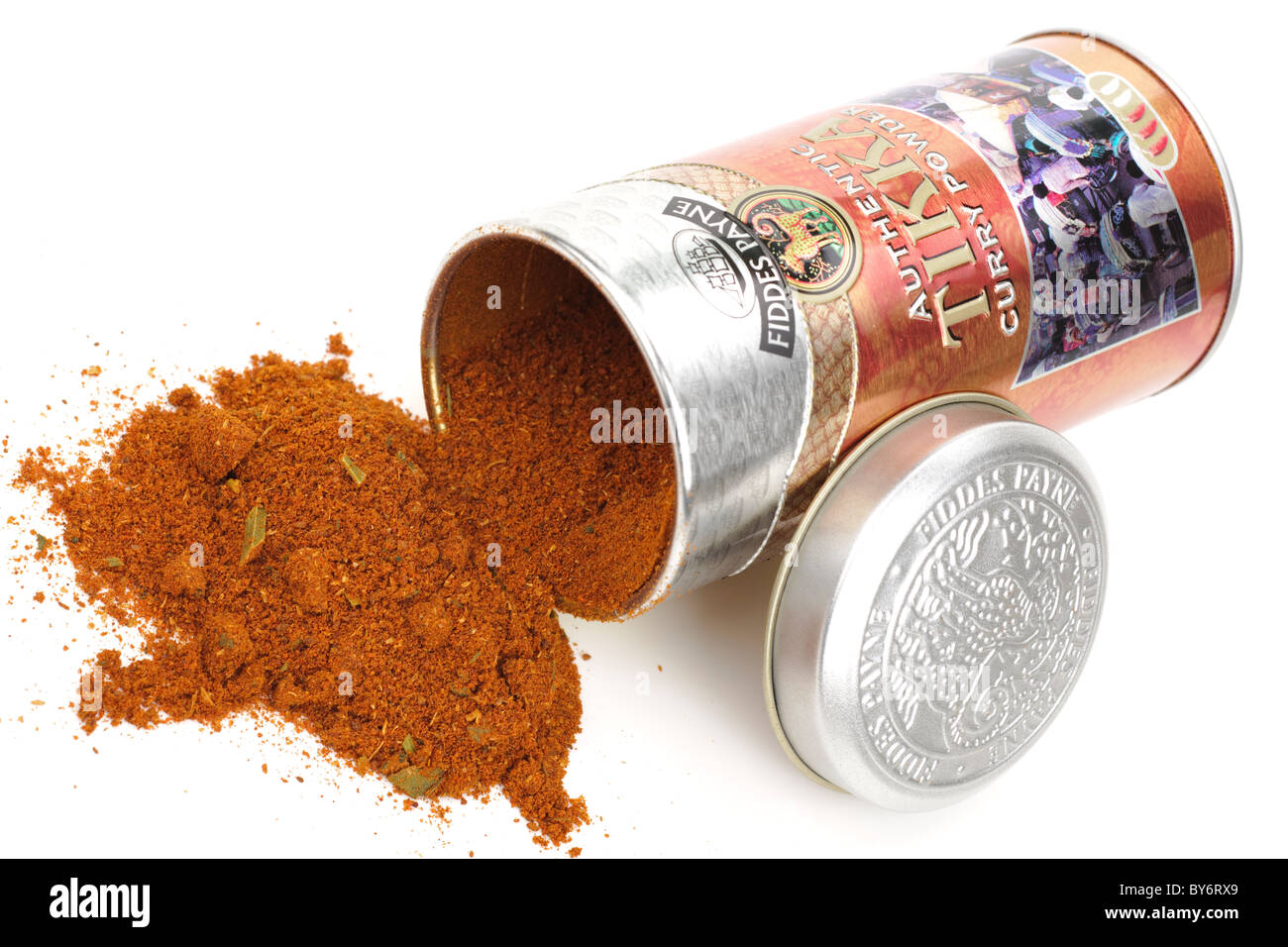 Container of  Fiddes Payne authentic Tikka curry powder spilling onto a white surface - Stock Image