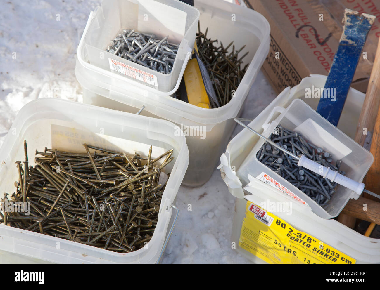 Warren, Michigan - Buckets of nails on the construction site of a Habitat for Humanity house. - Stock Image