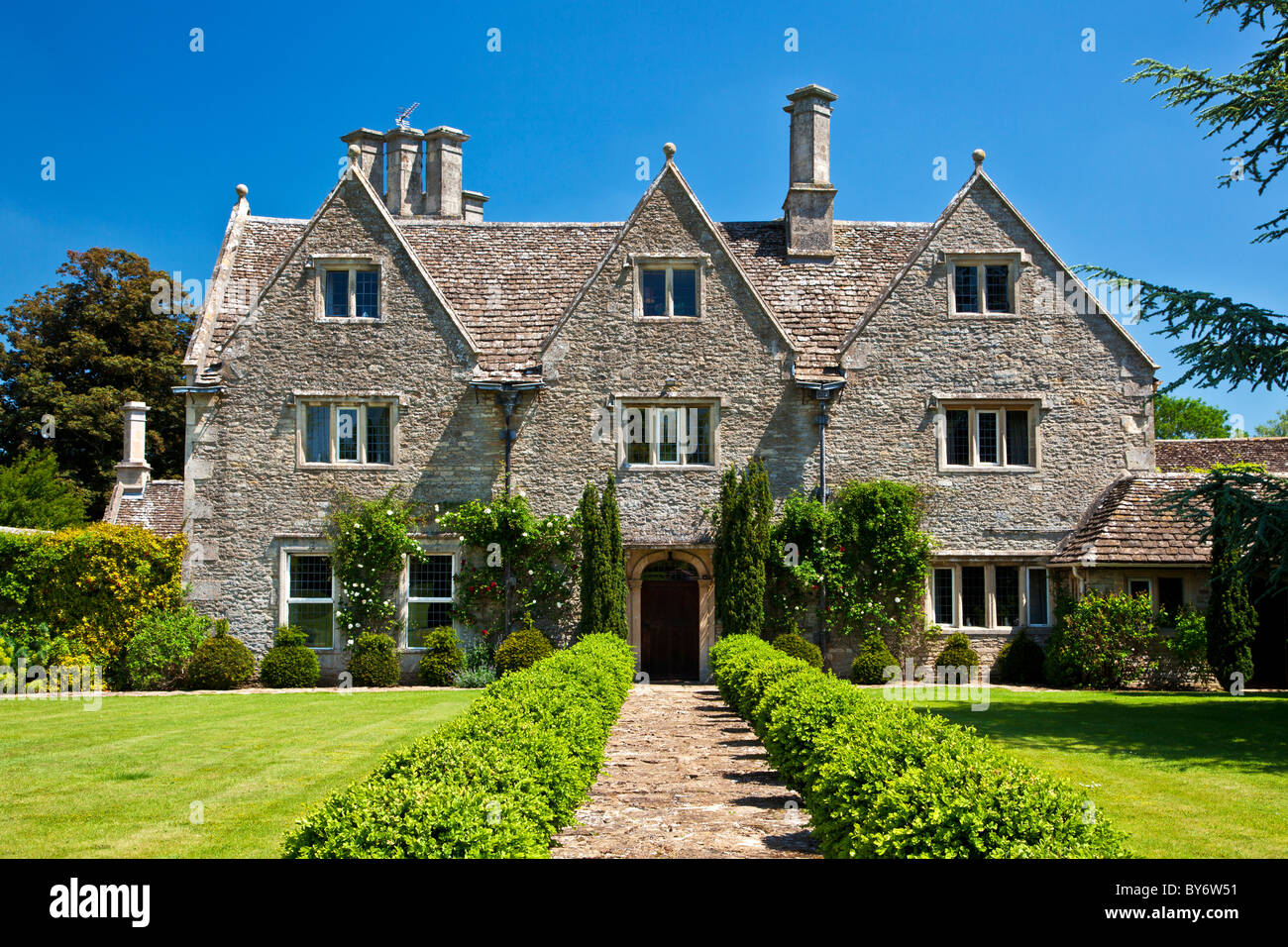 A grand english country manor house in summer stock photo for English country manor house plans