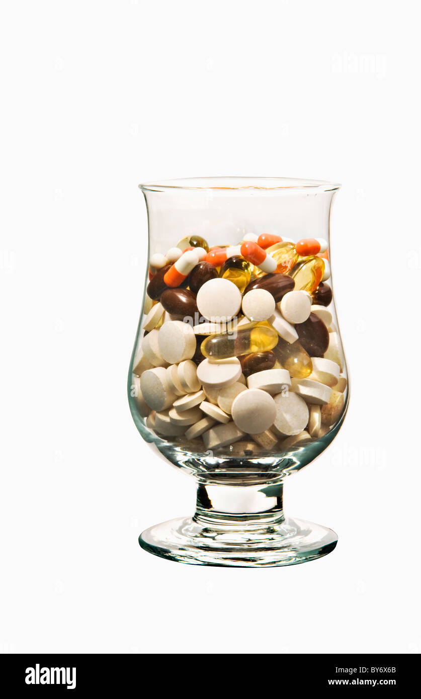 Cocktail of pills. Comprises various health supplements and drugs for treating high blood pressure (also known as - Stock Image
