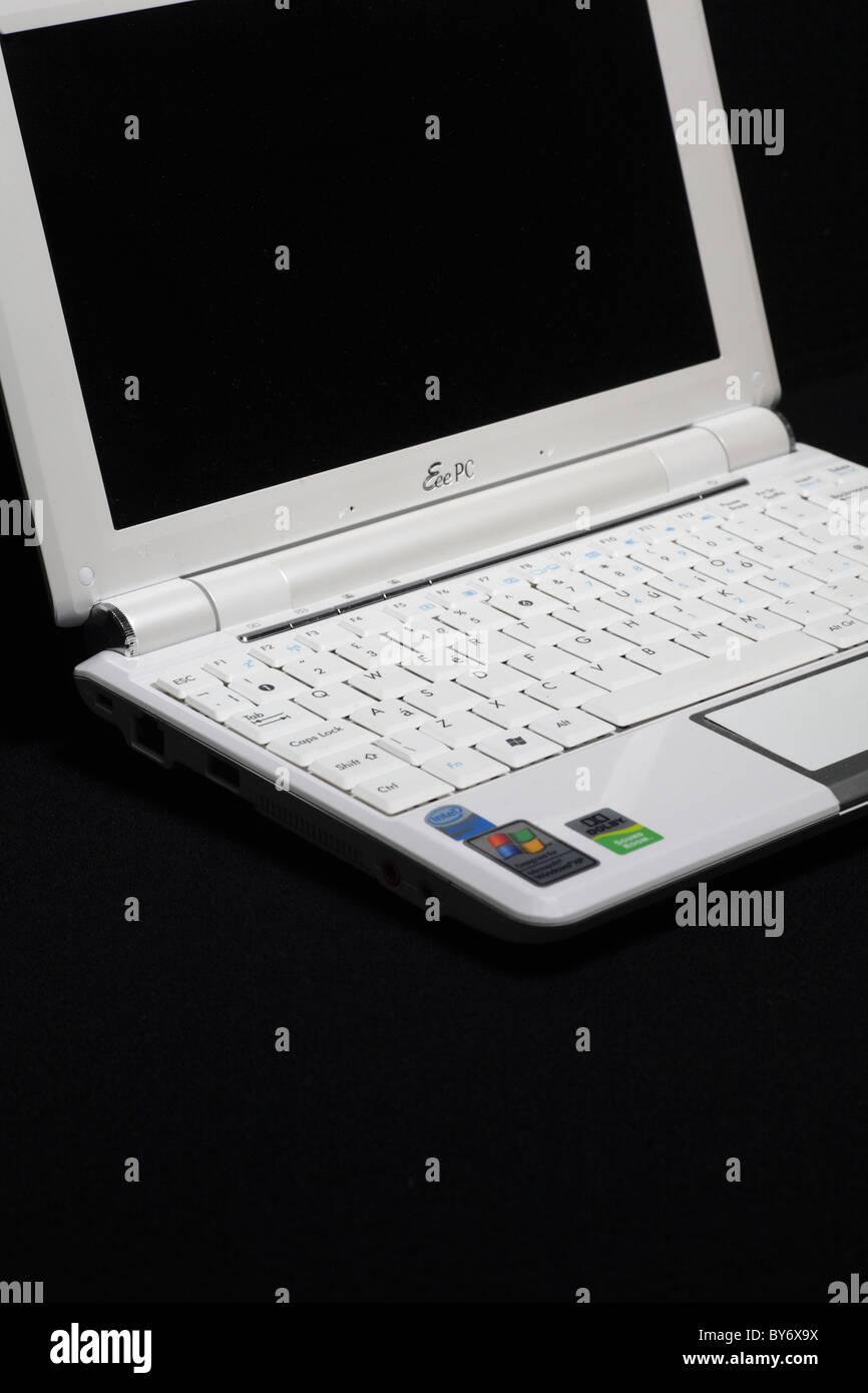 White Asus Eeepc 10 inch screen windows netbook mini laptop computer PC isolated on black - Stock Image