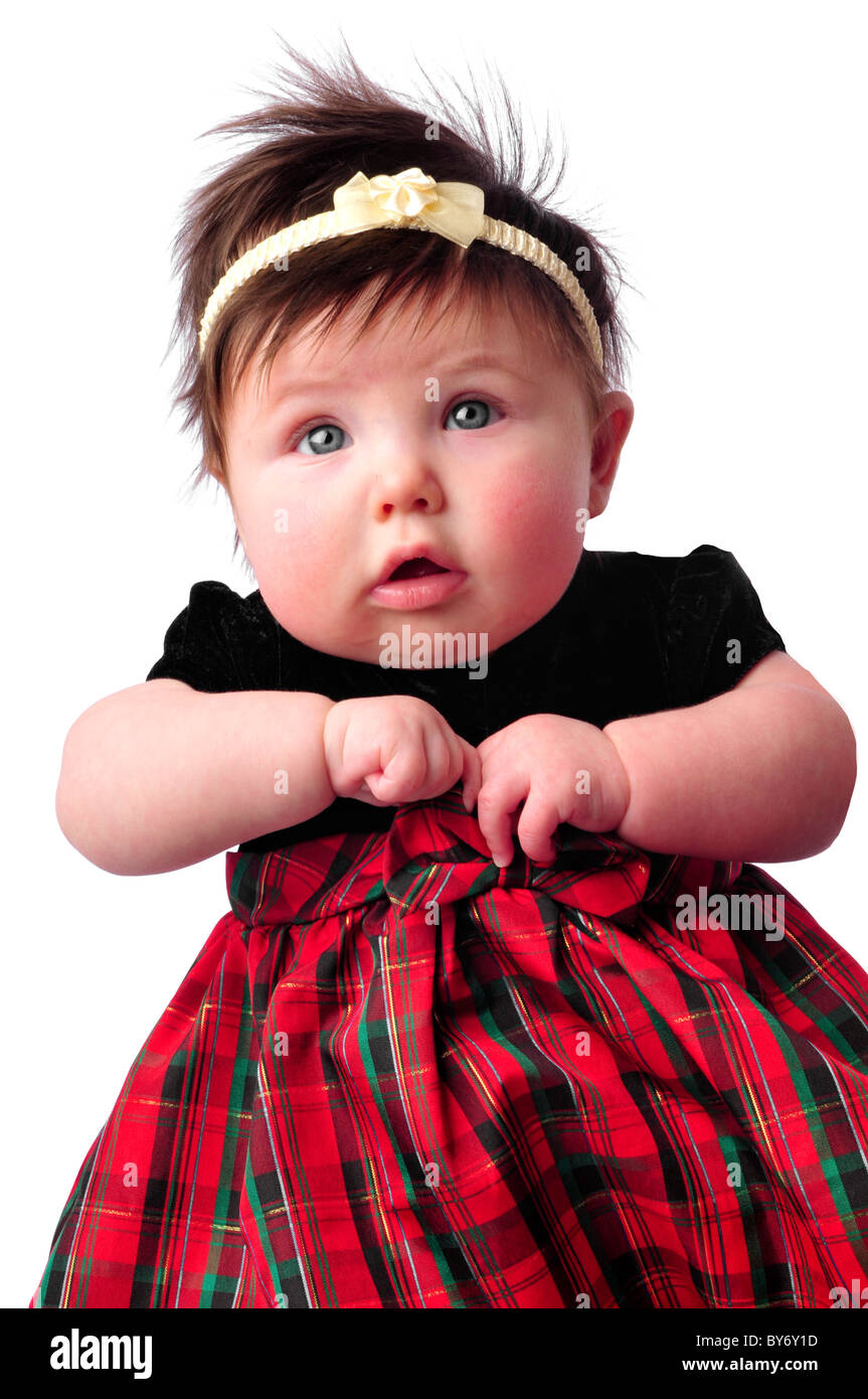 baby on white in checkered dress counting fingers - Stock Image