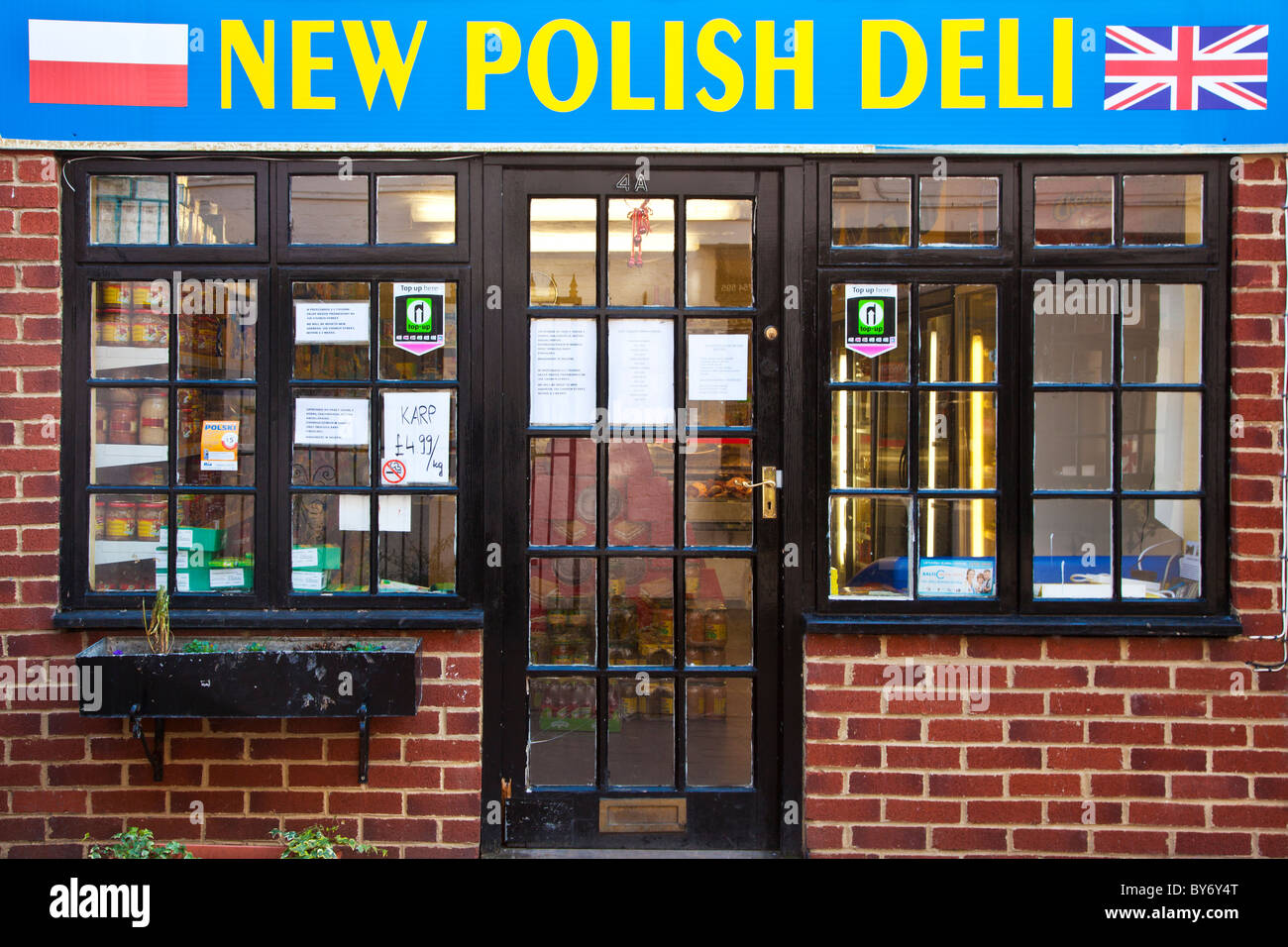 A typical Polish delicatessen or grocery shop in the English provincial town of Trowbridge, Wiltshire,England, UK - Stock Image