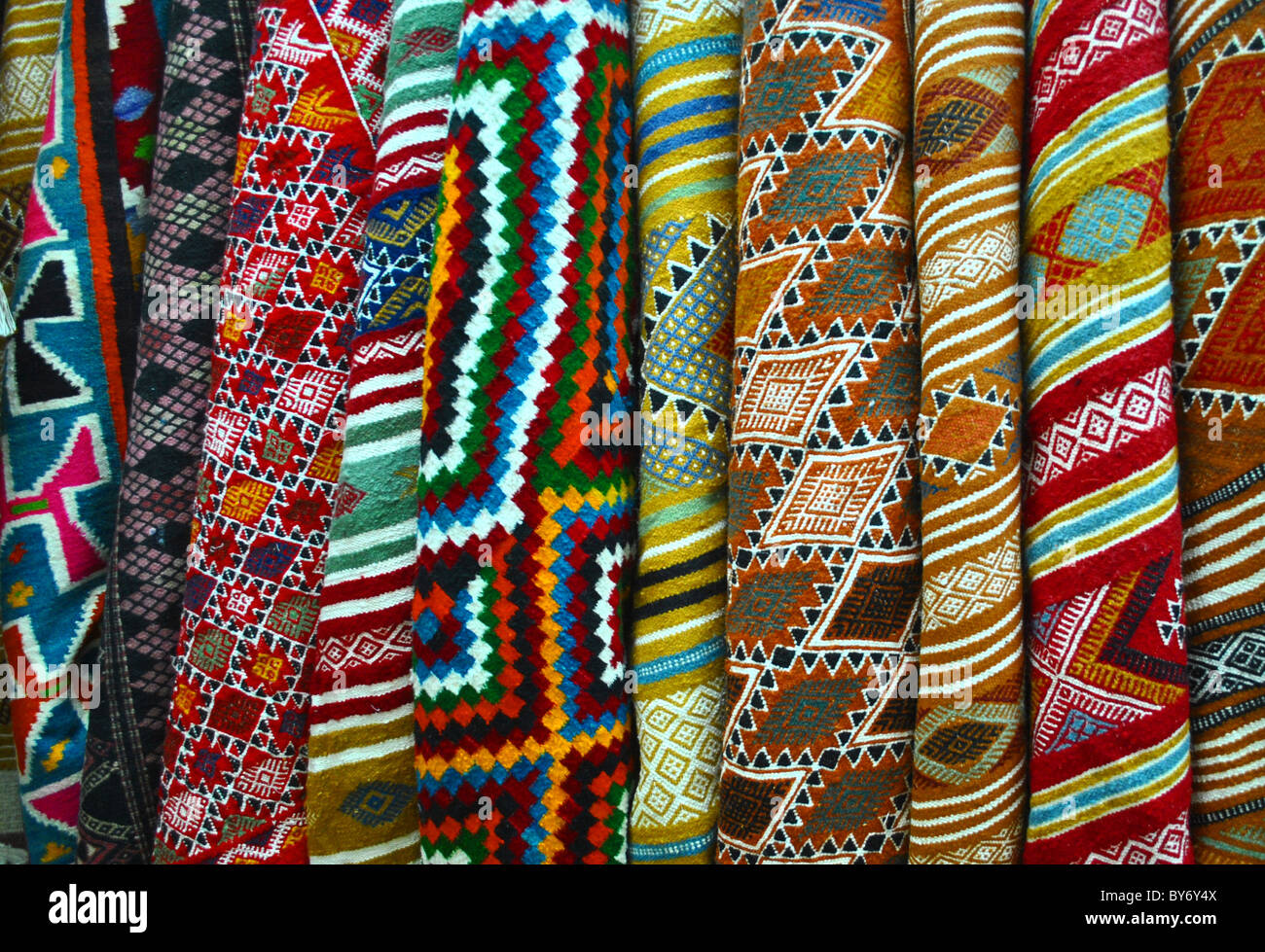 Colourful rugs for sale in a market in Sousse, Tunisia - Stock Image