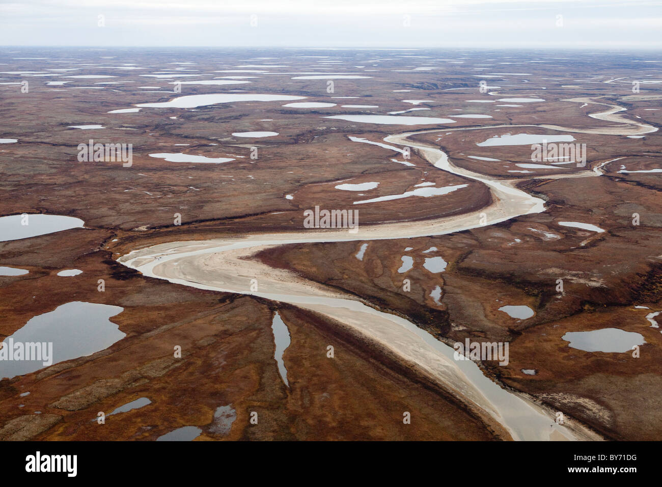 Aerial vews over the Yamal Peninsula in Western Siberia , Russia home to the Nenet tribes of nomadic reindeer herders. - Stock Image