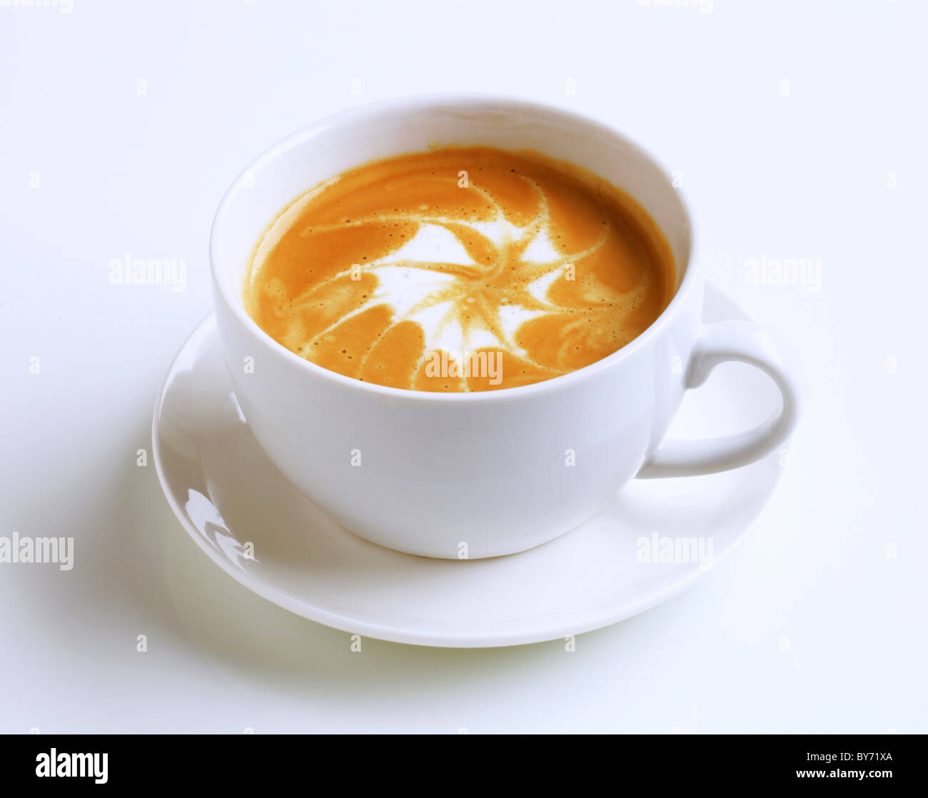 Cup of latte with froth art - Stock Image