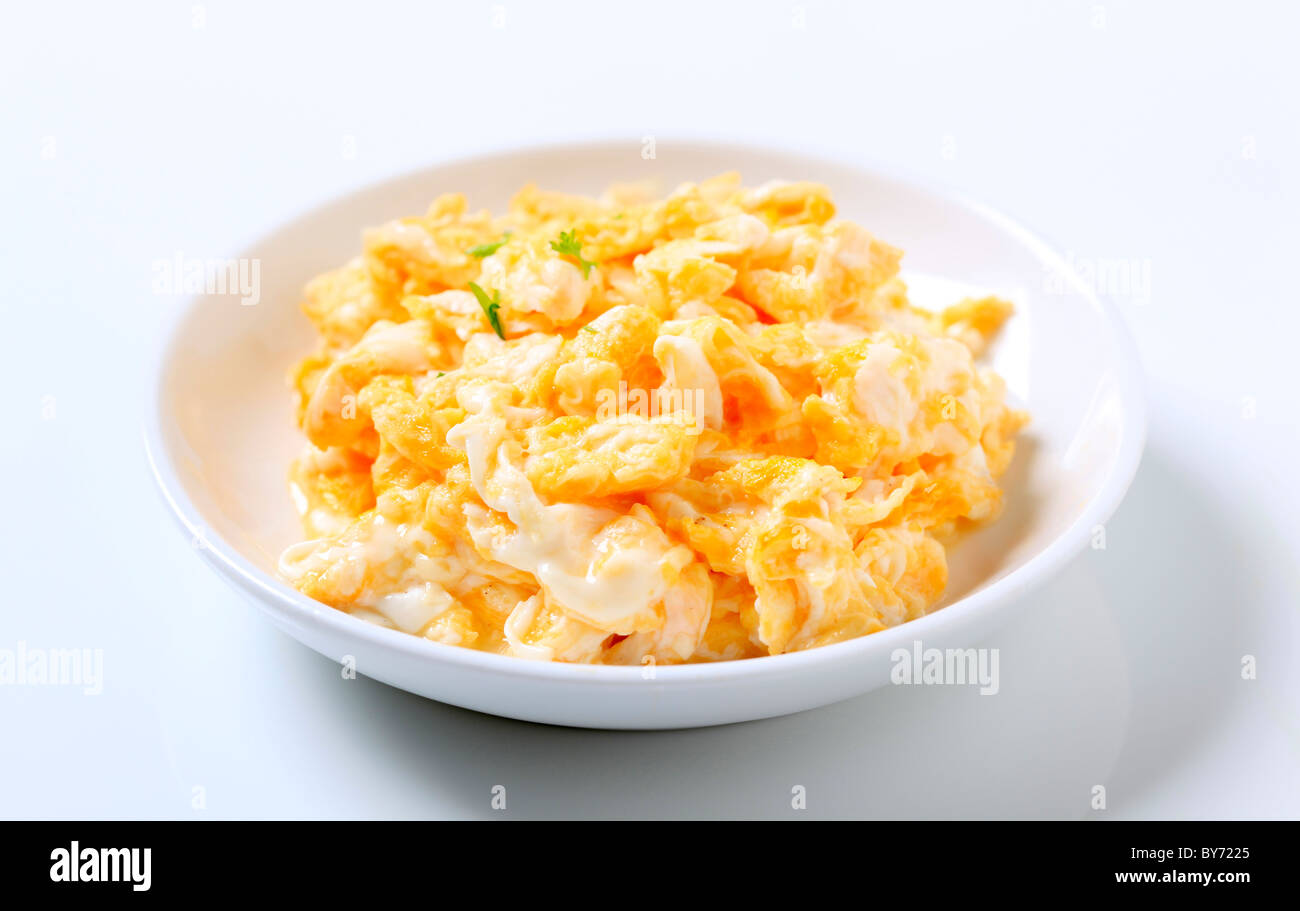 Scrambled eggs in a plate - Stock Image