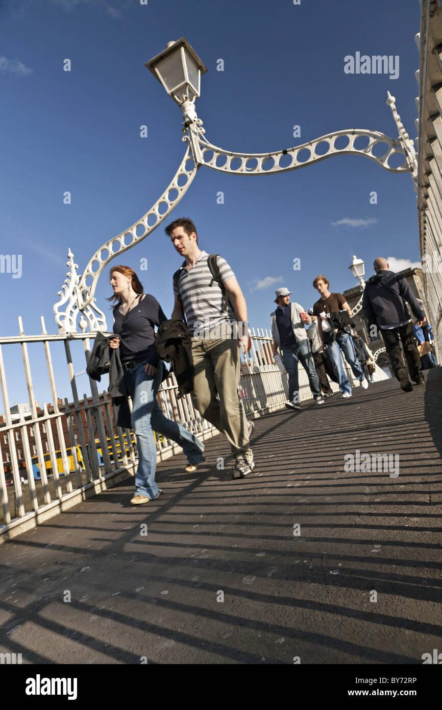 Passers-by on the Ha'Penny Bridge, Dublin, County Dublin, Ireland - Stock Image
