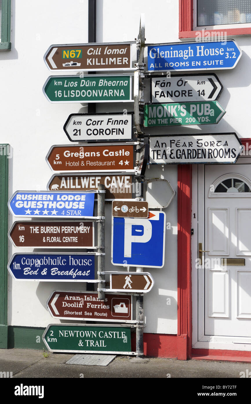 Signposts in the centre of the Ballyvaughan, Ballyvaughan, Galway Bay, County Clare, Ireland - Stock Image