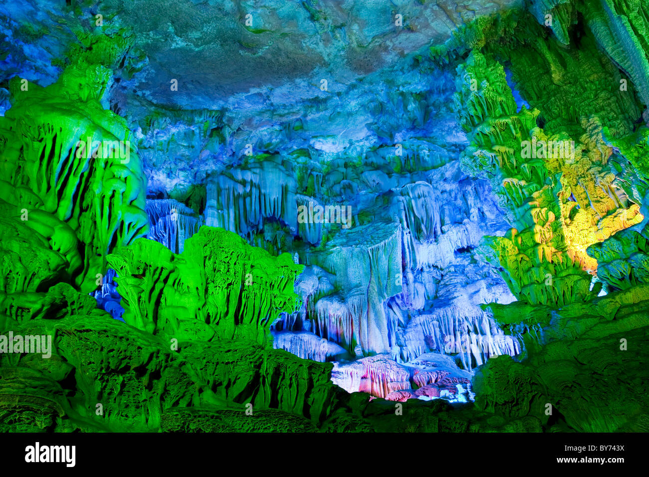 The beautifully illuminated Reed Flute Caves located in Guilin, Guangxi Province, China - Stock Image