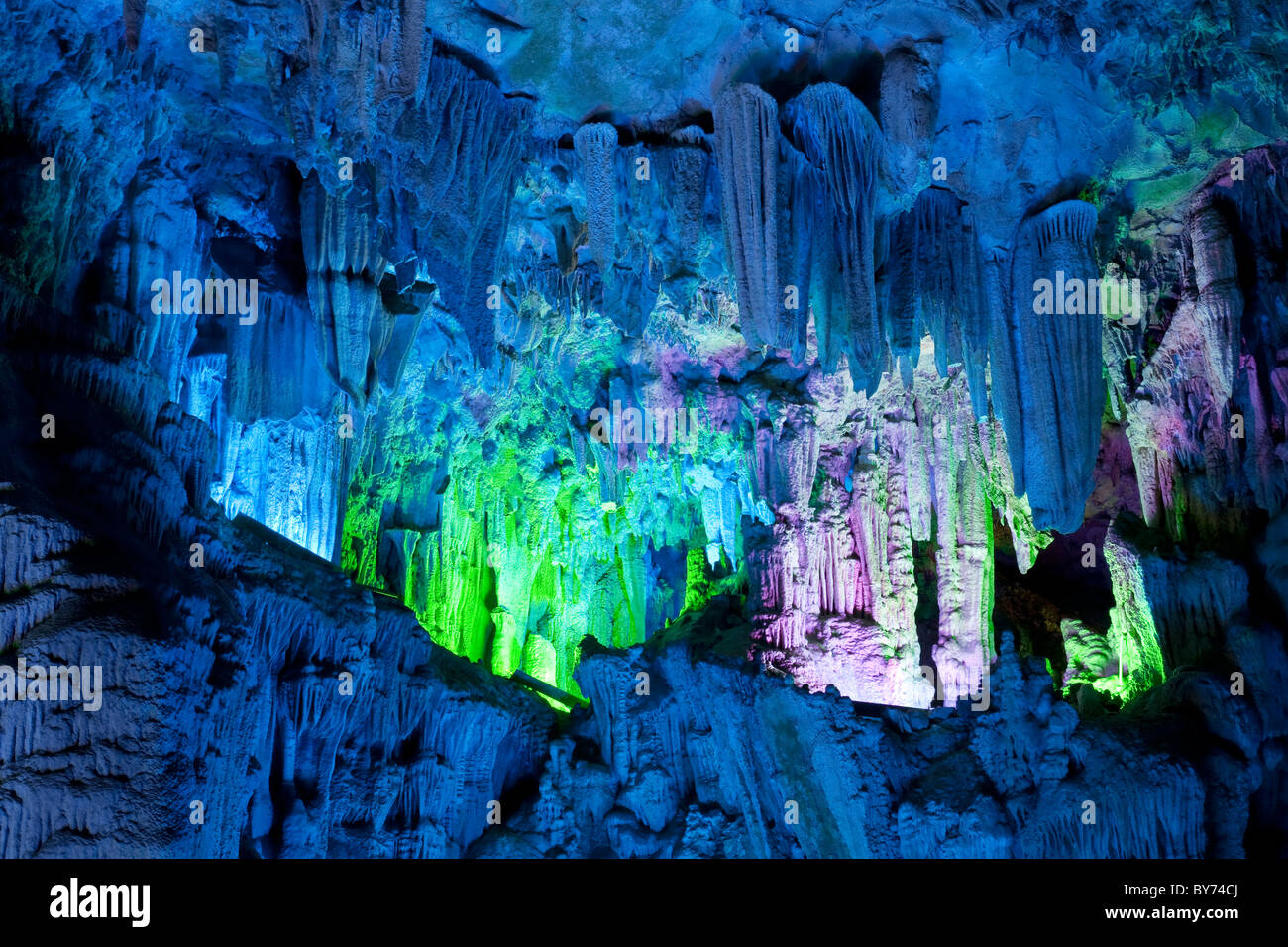 The beautifully illuminated Reed Flute Caves located in Guilin, Guangxi Provine, China - Stock Image