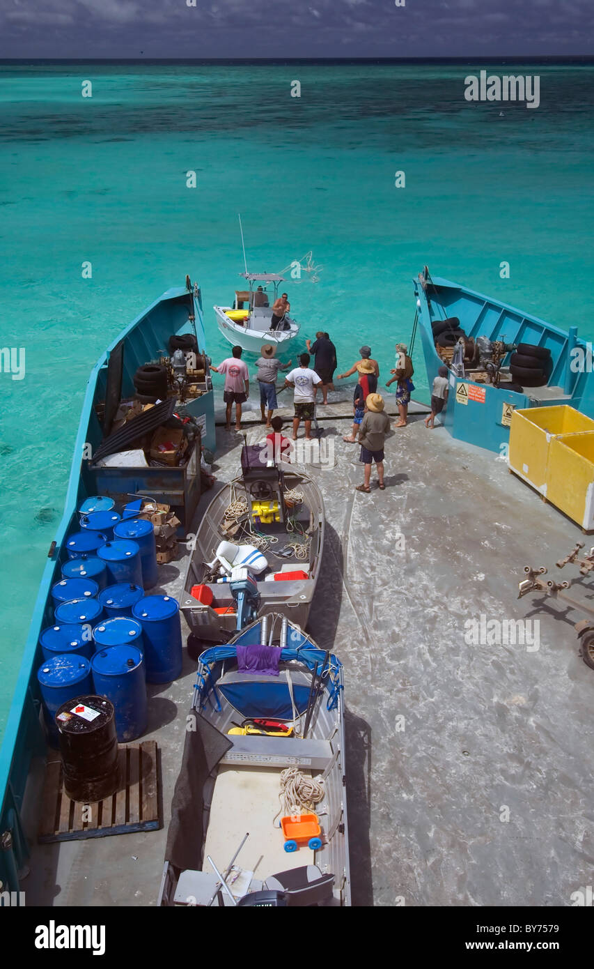 Loading boat onto barge at North West Island, Capricorn Bunker Group, southern Great Barrier Reef Marine Park. No - Stock Image