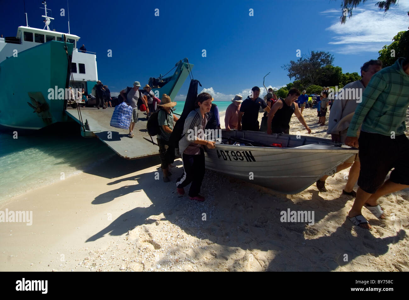 Resupply barge beached on North West Island, Capricorn Bunker Group, southern Great Barrier Reef Marine Park, Australia - Stock Image