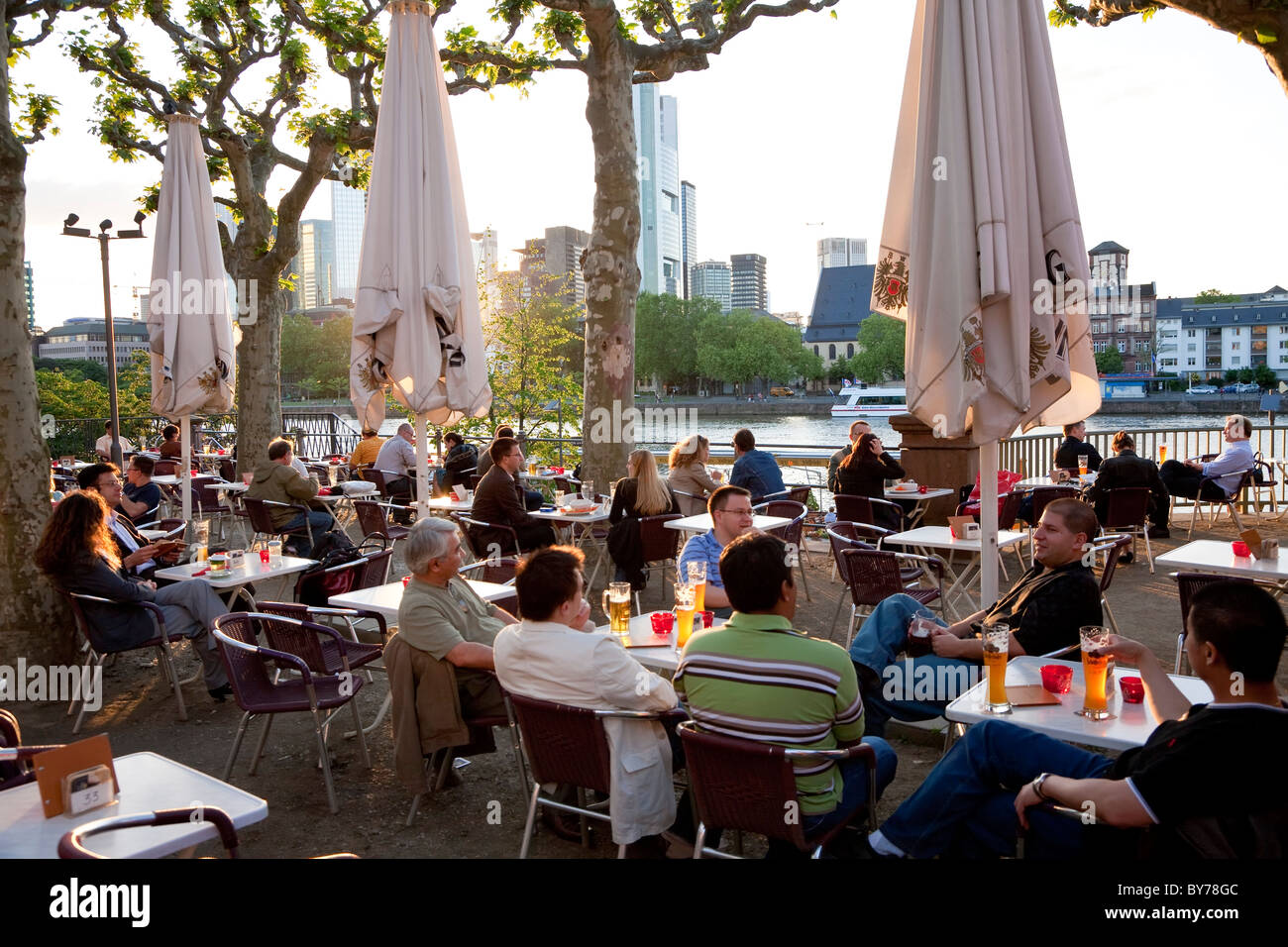 Outside cafe & beer garden, by Main river, Frankfurt, Germany - Stock Image