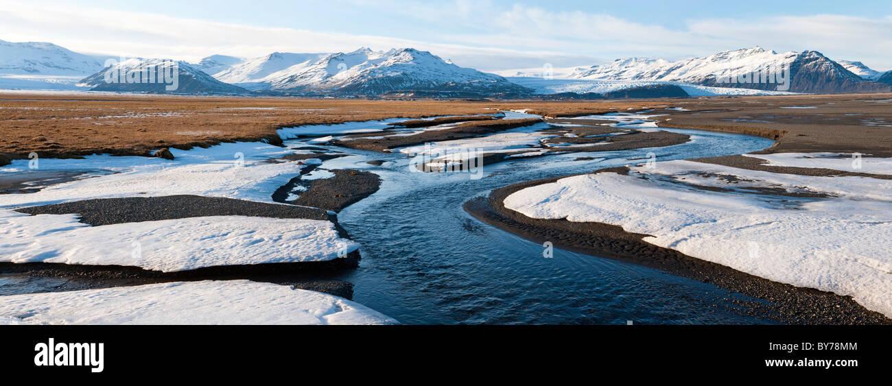 River & snow, Eskey, nr Hofn, S. Iceland Stock Photo