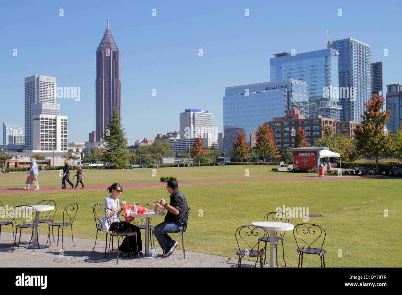 Atlanta Georgia downtown Pemberton Place World of Coca-Cola lawn skyline building man boy Bank of America Tower - Stock Image