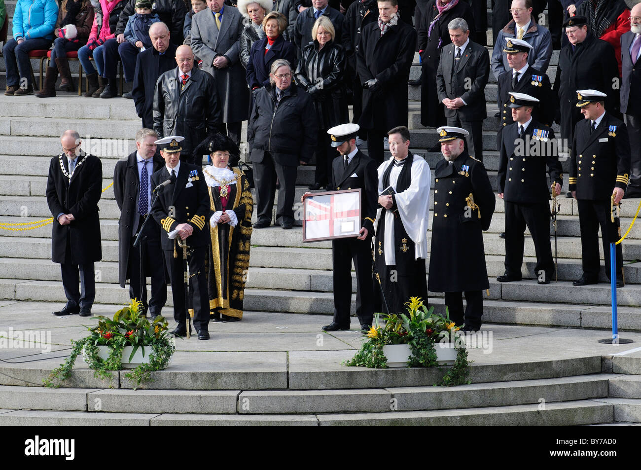 Lord Mayor of Portsmouth Cllr Paula Riches receiving a ship's white ensign during the decommissioning parade - Stock Image