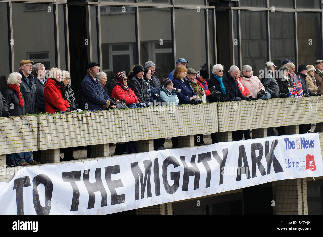 Spectators at the decommissioning parade and celebrations of HMS Ark Royal in Guildhall Square Portsmouth England - Stock Image
