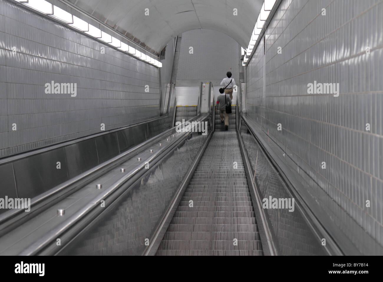Atlanta Georgia MARTA Peachtree Center Station underground mass transit public transportation escalator down descend - Stock Image