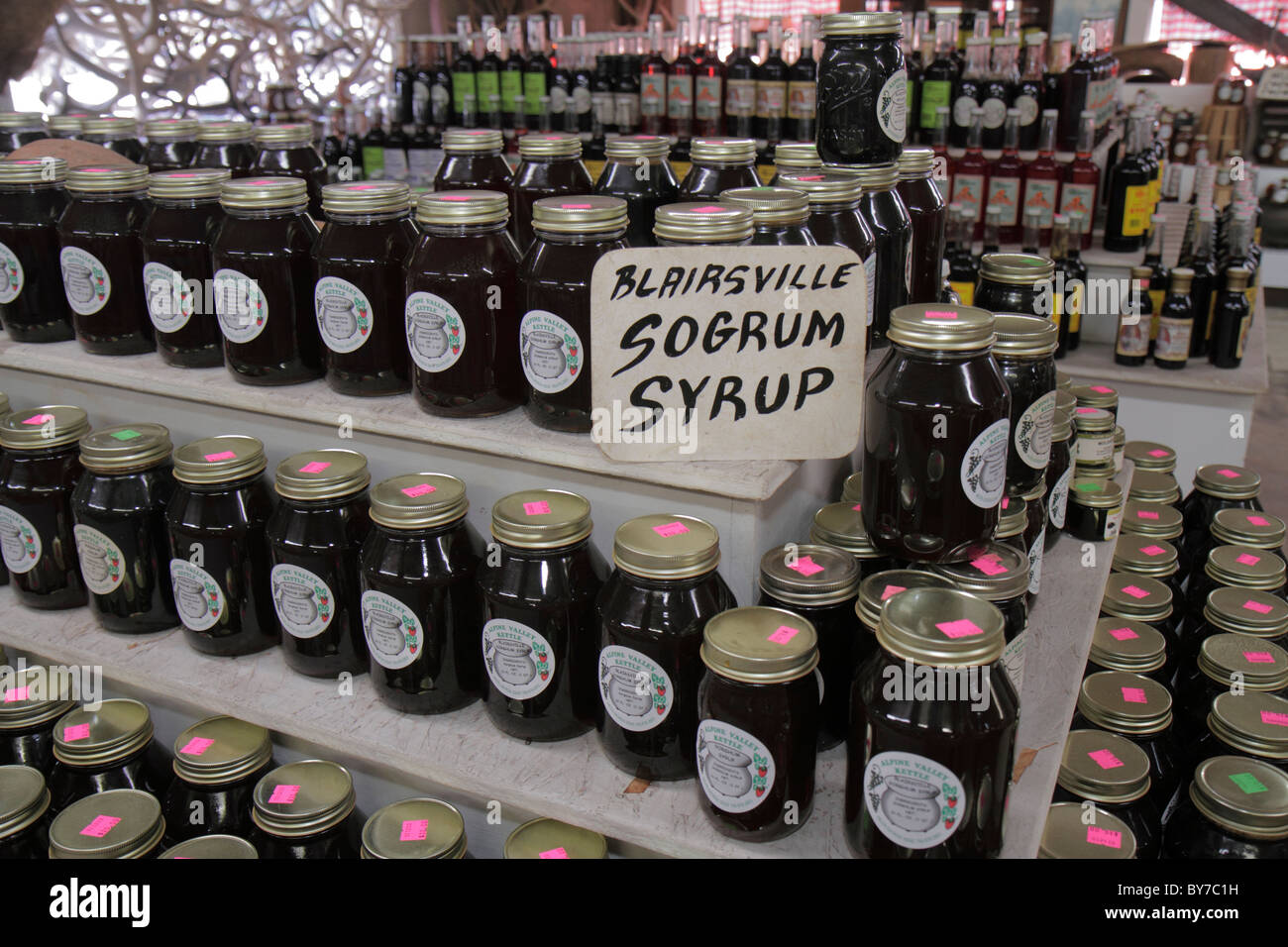 Georgia Robertstown produce stand farmers market local product glass jar display shopping sorghum syrup sweetener - Stock Image