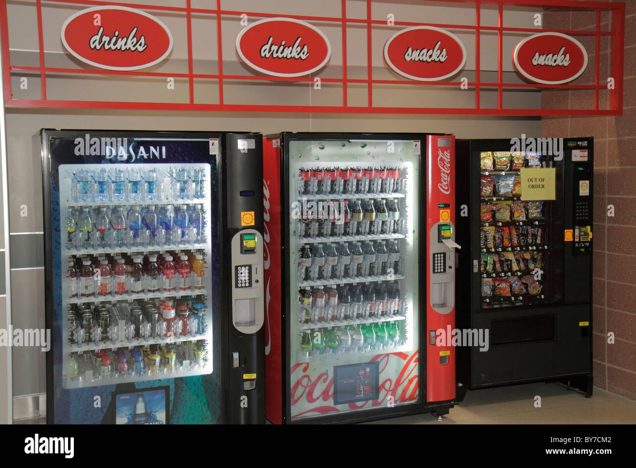Georgia Hartsfield-Jackson Atlanta International Airport ATL vending machine soft drink Coca Cola Dasani water soda - Stock Image