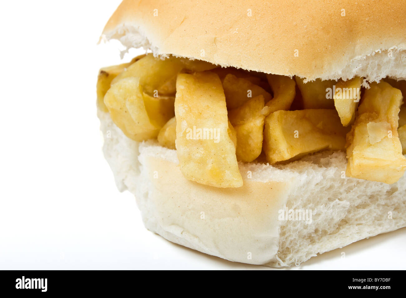 Traditional English chip butty isolated on white. - Stock Image