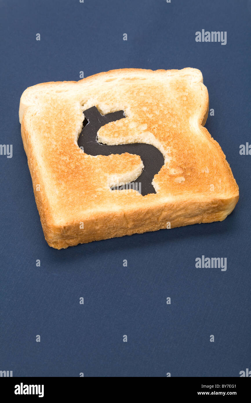 bread slice with dollar sign, concept high price of food or food for business - Stock Image