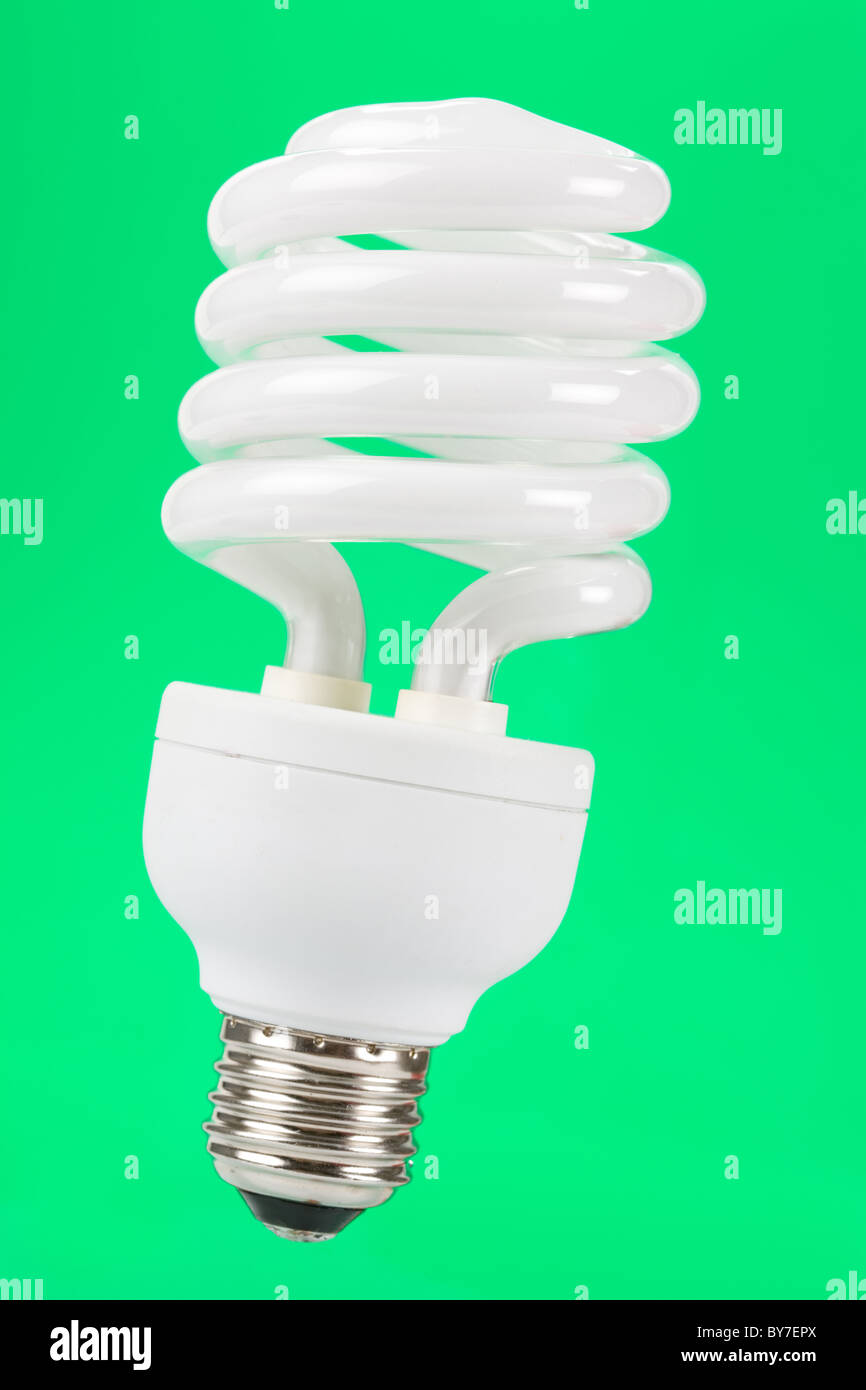Compact Fluorescent Lightbulb with green background - Stock Image