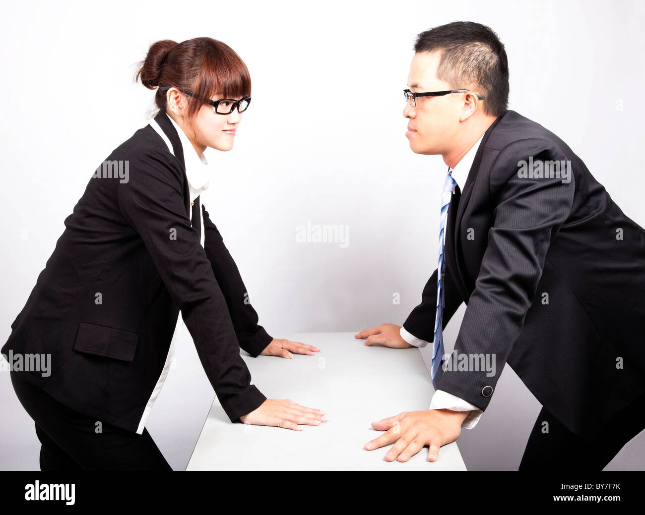 businessman and woman war in office - Stock Image