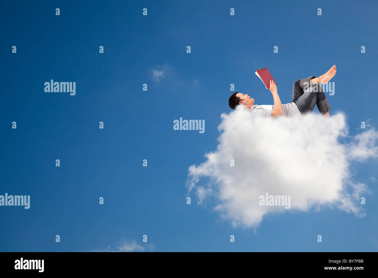 Relax and reading book on the cloud - Stock Image