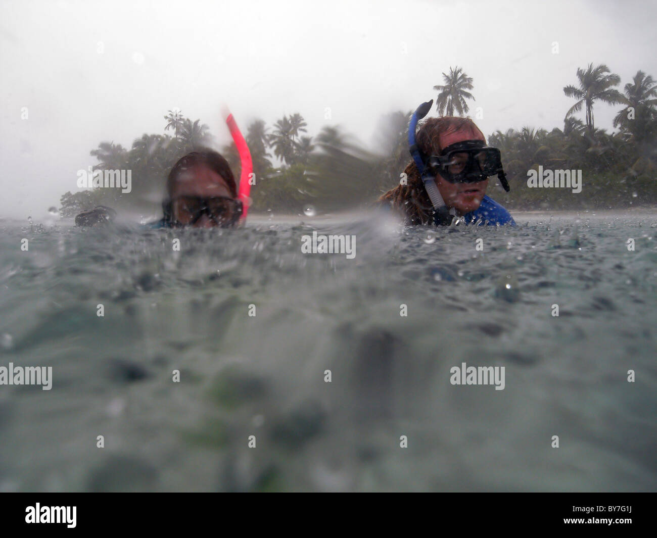 Snorkelling in the rain, Cocos Keeling atoll, Indian Ocean. No MR - Stock Image