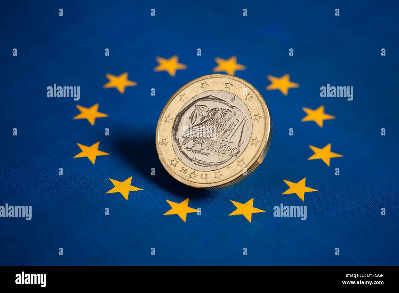 Greek Euro coin on the flag of the European Union - Stock Image