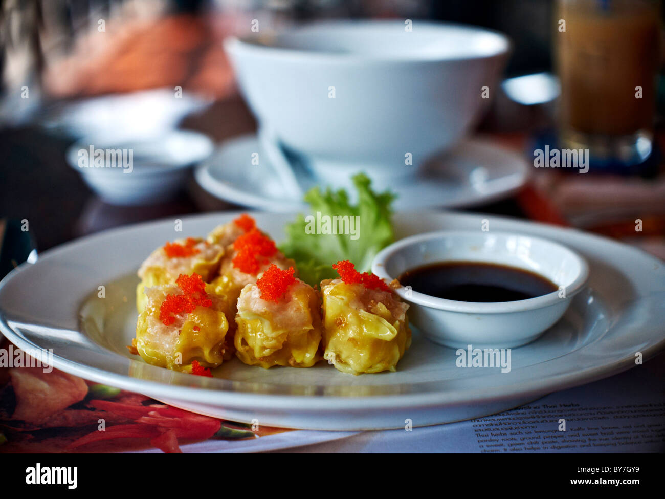 Dim Sum appetizer and complementary sauce dip. Thailand S. E. Asia - Stock Image
