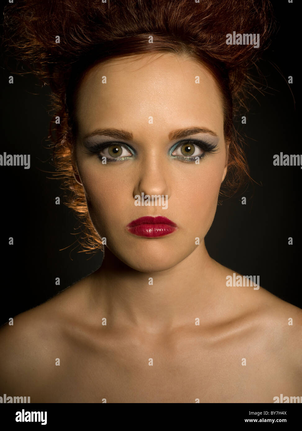 Red Queen portrait - serious, unsmiling, frowning, severe, forbidding, grim, unfriendly, austere, dour, stony, flinty, - Stock Image