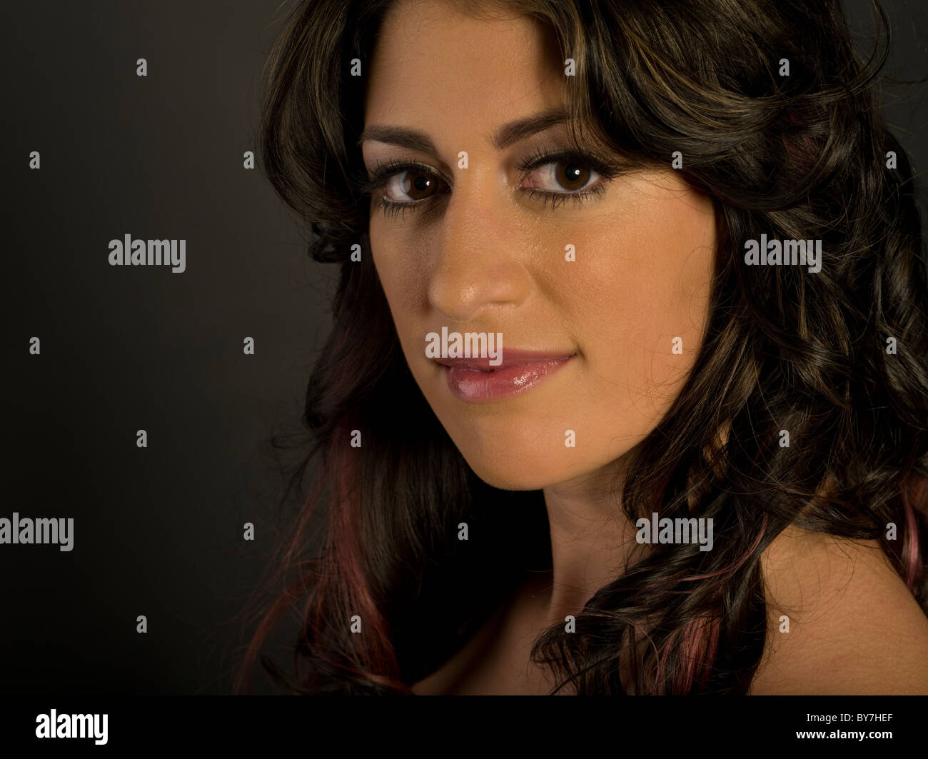 Portrait of beautiful brunette woman twenties thirties - Stock Image