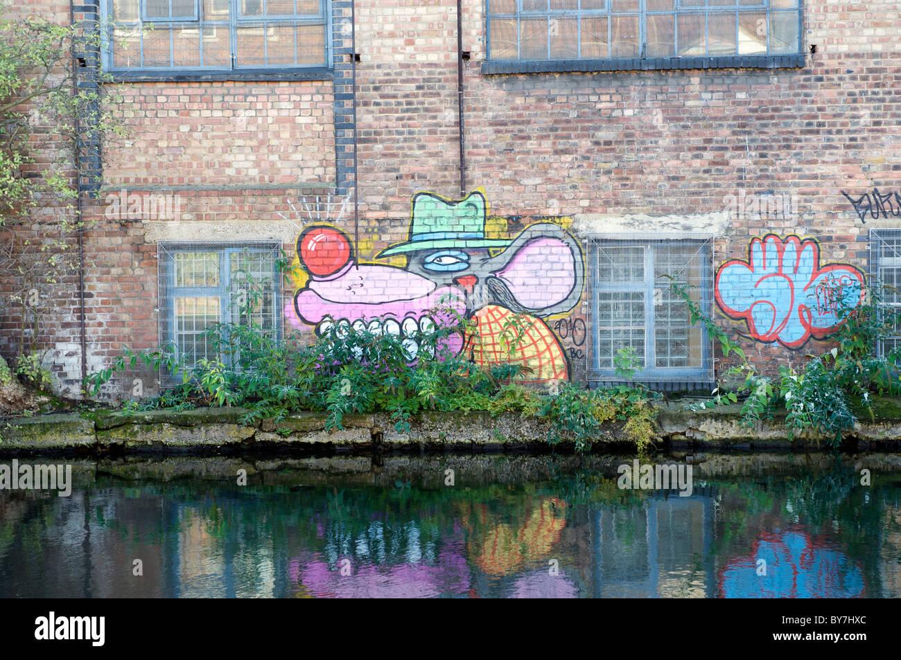 graffiti alongside Regents canal Hackney East London - Stock Image