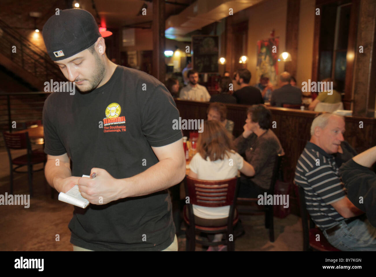 Tennessee Chattanooga Terminal Brew House restaurant pub business beer casual dining drinking man waiter taking - Stock Image