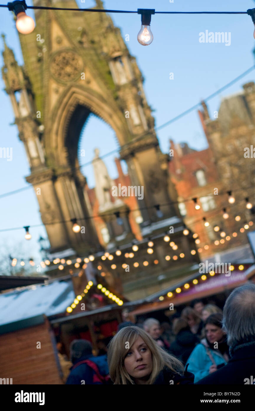 Visitors to the Manchester (England) Christmas market in Albert Square - Stock Image