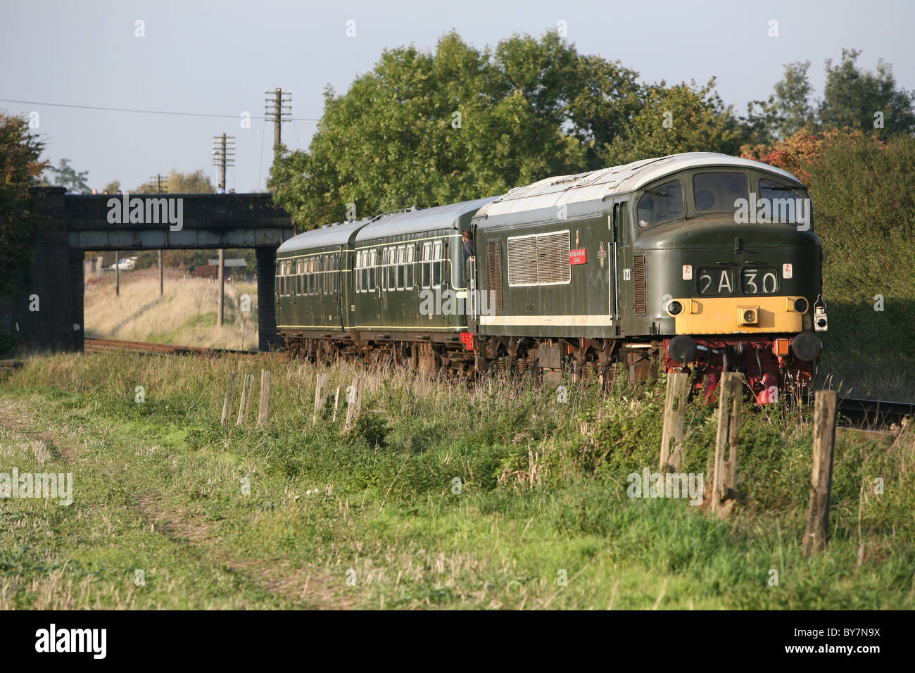 broken down dmu being pushed by a diesel back to loughborough great central railway - Stock Image