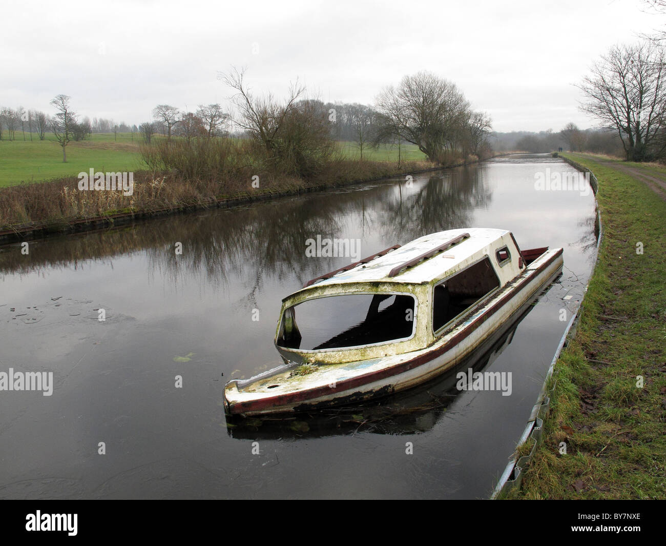 sunken boat on the Liverpool to Manchester canal near Wigan - Stock Image