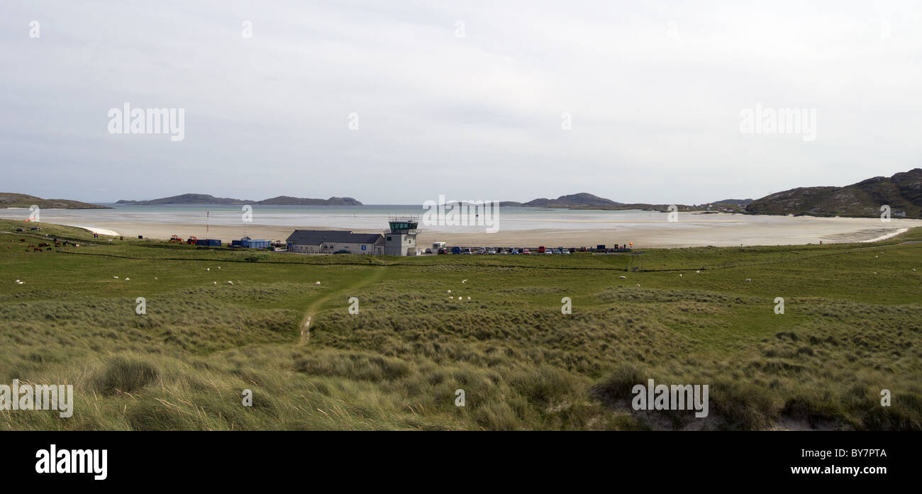 Airport building and control tower on Isle of Barra, Outer Hebrides, Scotland (beach is used as airport) - Stock Image