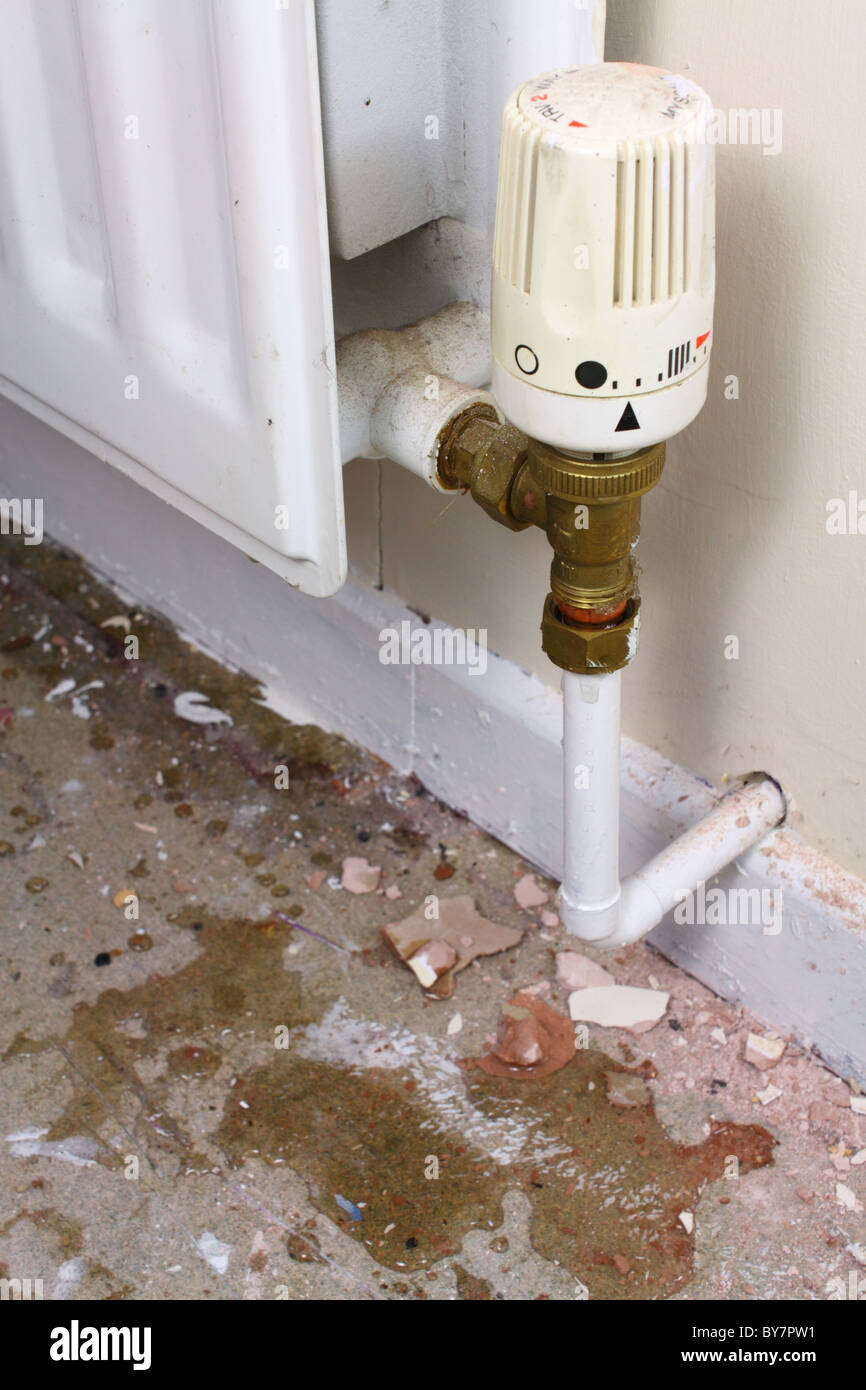 Small leak from radiator pipe - Stock Image