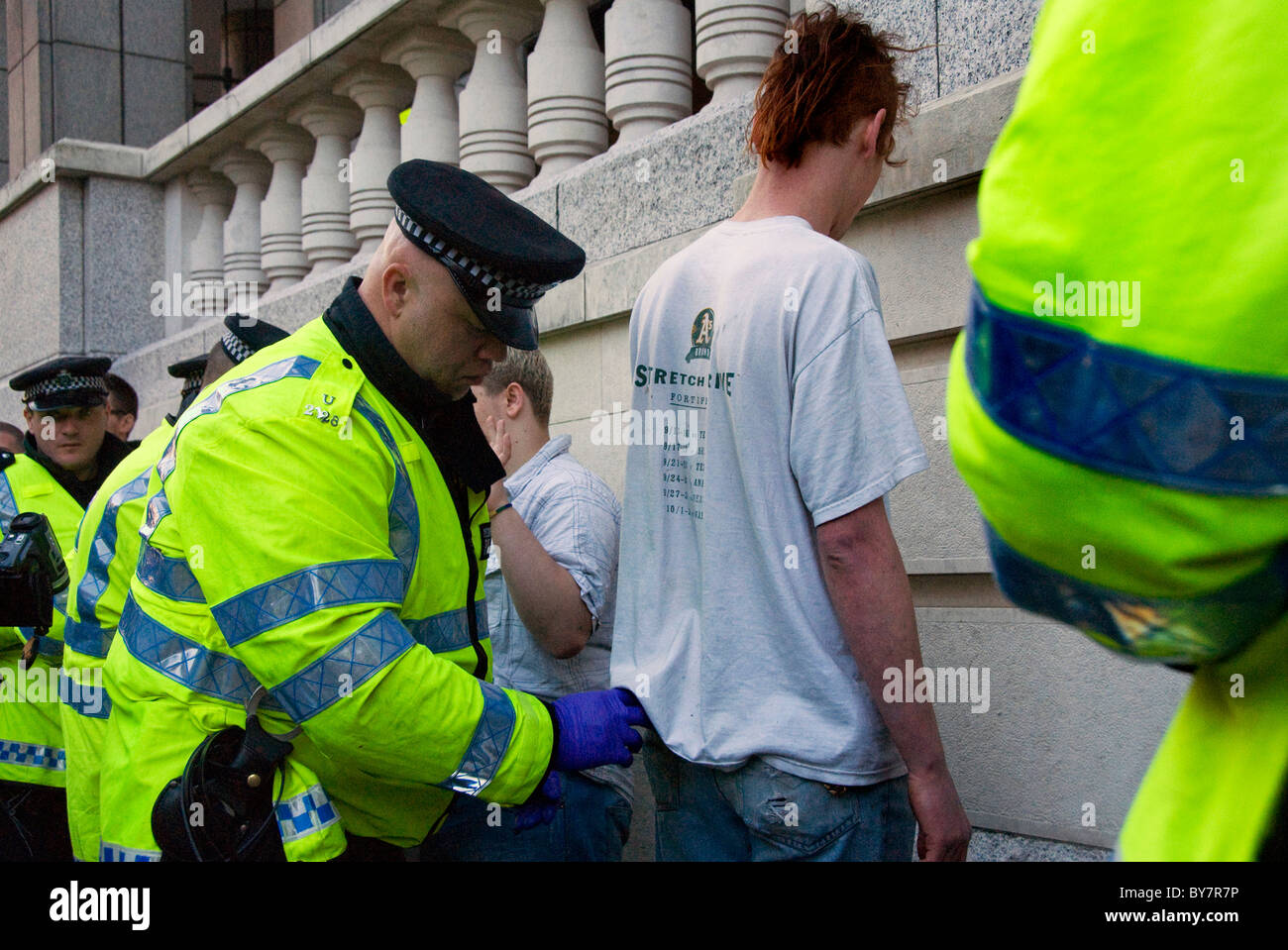 Police stop and searching youths after G20 demonstration - Stock Image