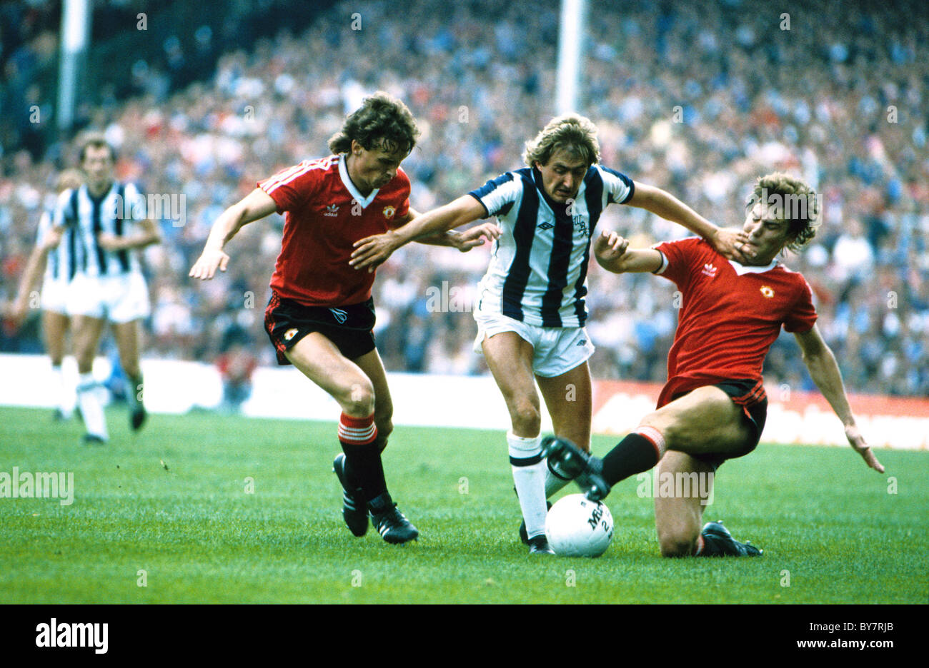 West Bromwich Albion V Manchester United Gary Owen of WBA between Mike Duxbury and Brian Robson 1980s - Stock Image