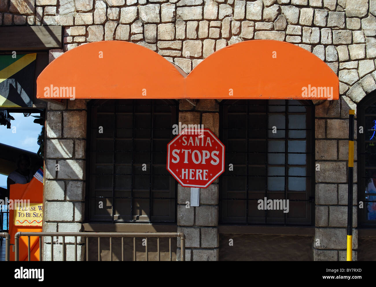 Novelty 'Santa Stops Here' sign, Montego Bay, Jamaica, Caribbean. - Stock Image