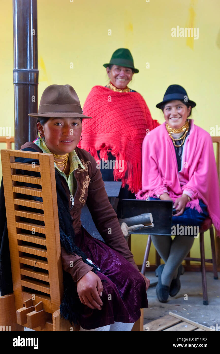Indigenous women around wood stove, Quilotoa, Central Highlands, Ecuador - Stock Image