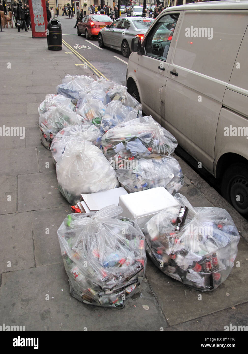 Rubbish bags waste bin bags recycle litter mess - Stock Image