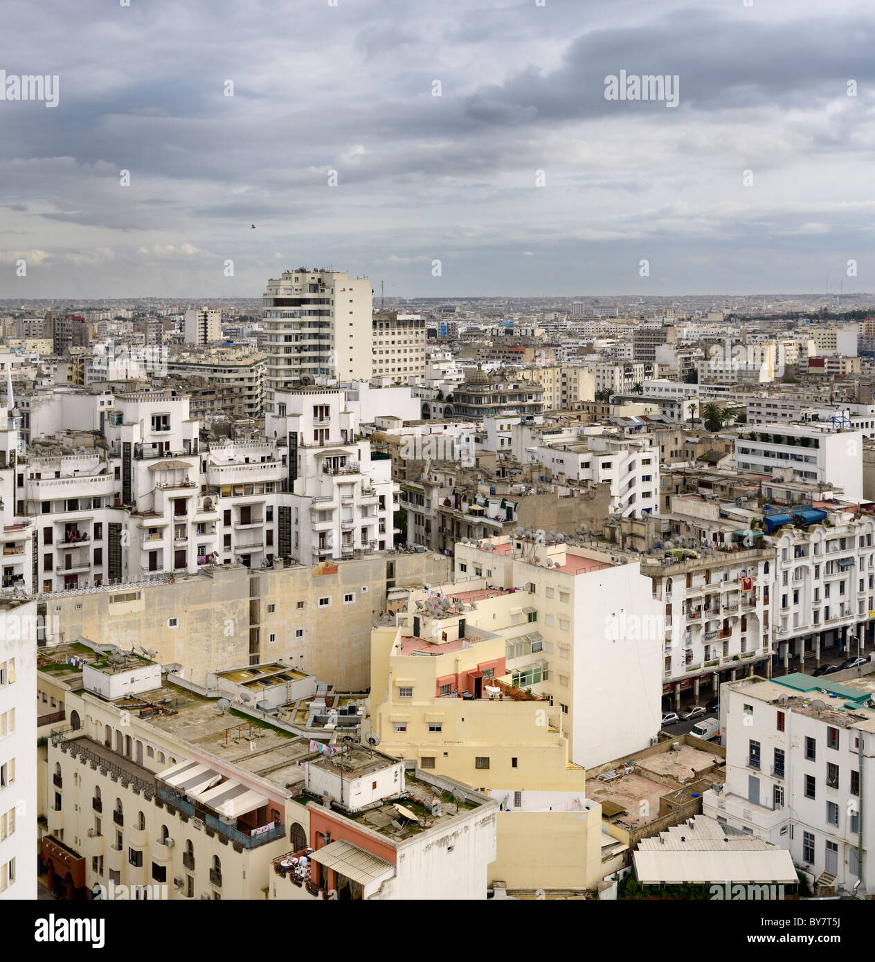 Daytime view of the white Casablanca cityscape with clouds Morocco - Stock Image