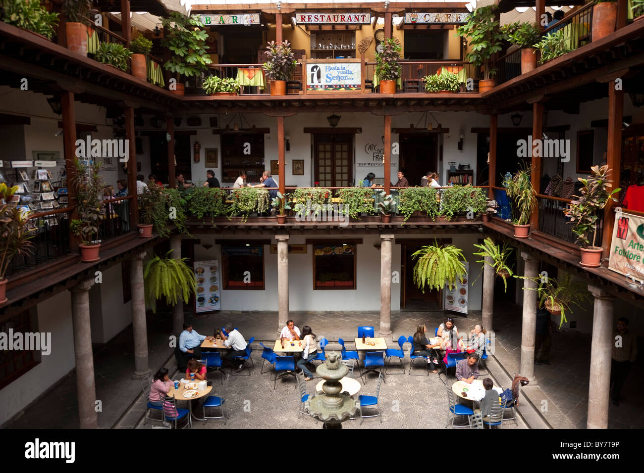 Ecuador Quito Palacio Arzobispal, Overhead view of small cafe tables inside shopping courtyard in Old Town - Stock Image